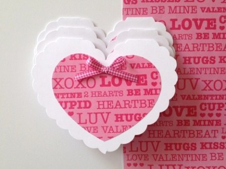 Smaller pink heart attached to scalloped background heart.