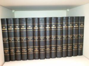 Blue bound encyclopedias on a shelf.