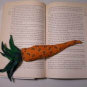Carrot page weight on open book