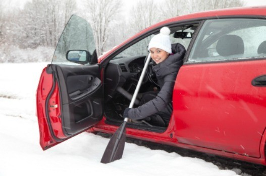 A girl trying to drive on snow and ice.