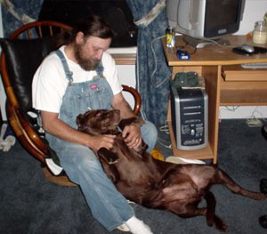 chocolate lab and owner