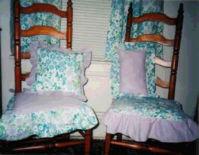 Curtains, pillow, and chair cushions from vintage sheet.
