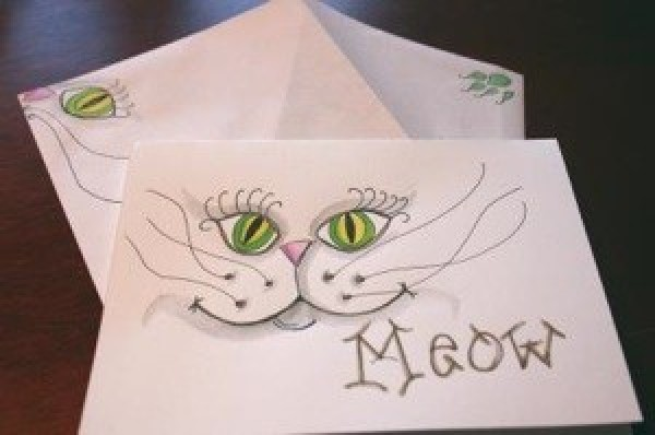 Watercolor note card of cat's face.