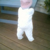 Standing baby on porch.