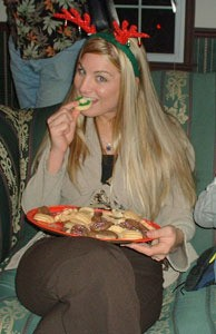 Young woman with plate of cookies