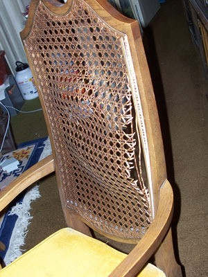 Broken cane back chair.