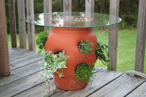 Strawberry pot with a glass table top.