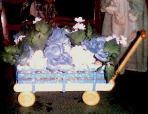 Floral arrangement in wagon.