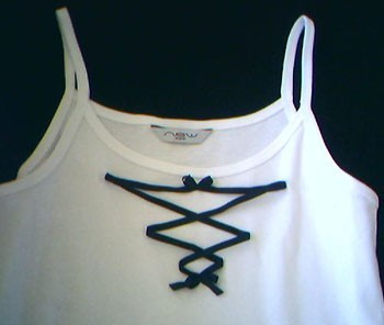 Faux ribbon lacing on tank top.
