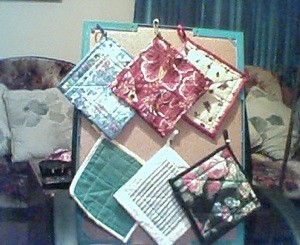 Potholders on bulletinboard.