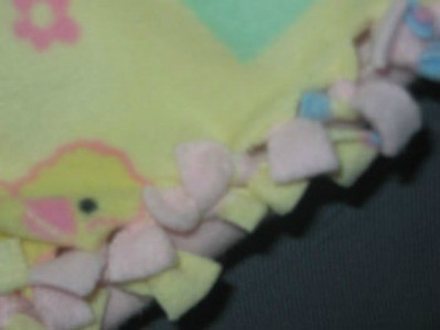 Yellow print fleece doll blanket.