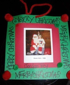 Santa photo on red and green paper backgound.