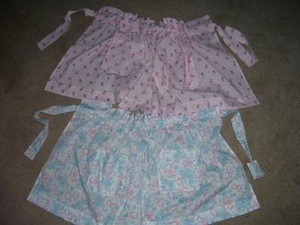 Pink and blue aprons.