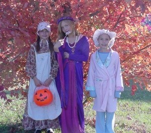 Three children in costume.