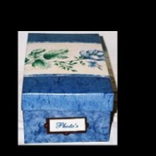 Box covered with blue and flowered paper.