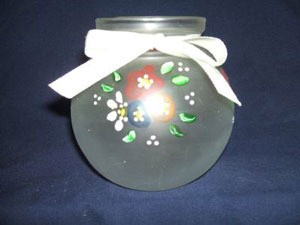 Painted votive candle holder.