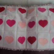 white blanket with red and pink hearts