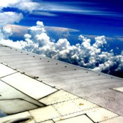 clouds above airplane wing