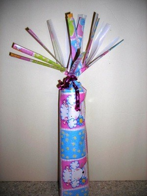 Gift wrapped cylinder.