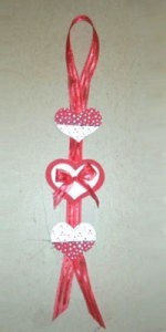 Red and white heart wall hanging.
