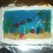 A cake made with blue jello to mimic an aquarium.