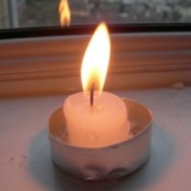 A candle stub in an old tea light holder.