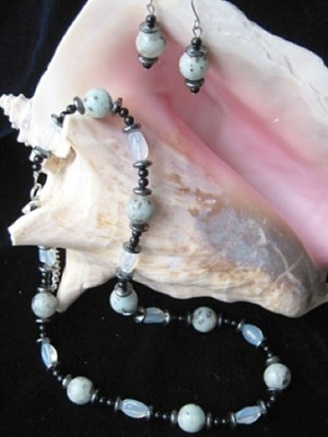 Sea shell with jewelry.