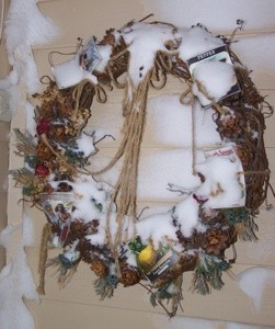 Snow on door wreath.