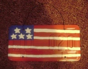 car license plate painted as stylized American flag