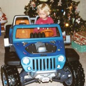 Girl in toy jeep