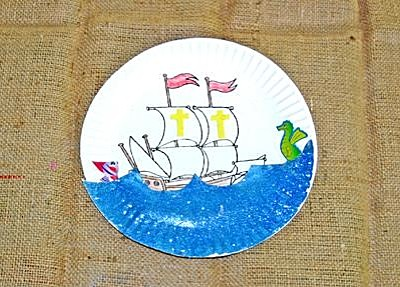sailing ship on the ocean painted on paper plate