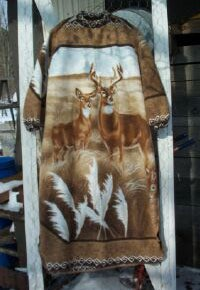 Dress made from a blanket with an image of a buck and doe deer in a field of wheat