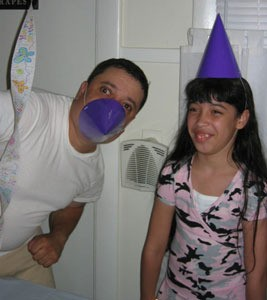 Dad with party hat over nose