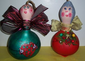 two beautifully painted gourd angels