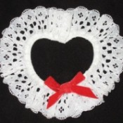 A lacy heart from white doilies, for a napkin rings.