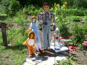 Homemade garden character decorations.