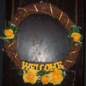 Decorated grapevine welcome wreath.