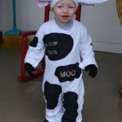 toddler in cow costume