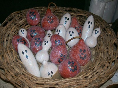 white and orange gourd ghouls in basket