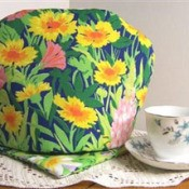 bright yellow flowered tea cozy and hot pad