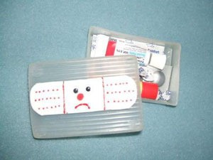 kit with frown face band aid on cover
