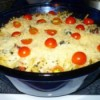 spinach chicken pasta dish with cherry tomatoes