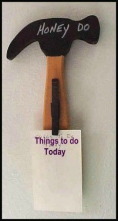 "wooden cutout of a hammer with a clothespin to hold a list of ""to do projects"""