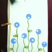 Decorative cover on homemade notepad.