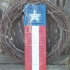 Flag Painted Shutters - finished shutters in front of a natural twig wreath