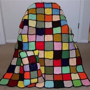 Multicolored block afghan and pillow.