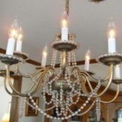 Chandelier hung with beads.