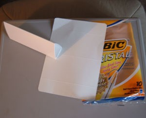 Cardboard pyramid from Bic pen package.