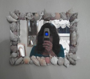 Mirror decorated with shells.