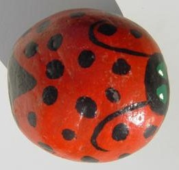 Rock painted to look like ladybug.